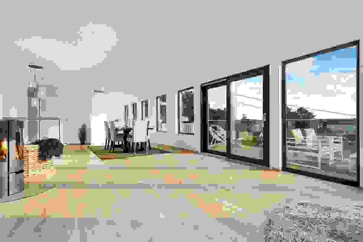 """Tross den store gulvflaten, er stuen inndelt i naturlige """"avdelinger"""", og dette fasinerende rommet er det opplagte """"hjertet"""" i huset."""