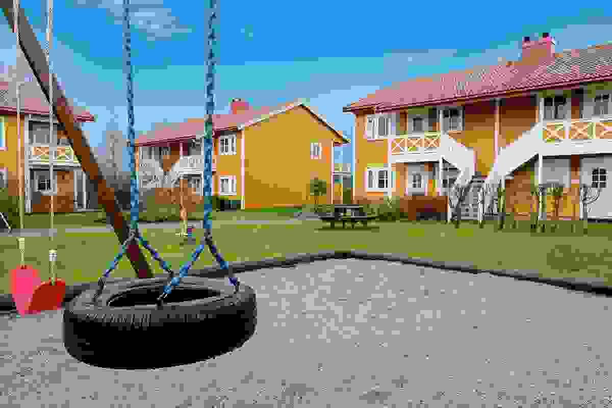 Fellesområde med lekeplass for de små