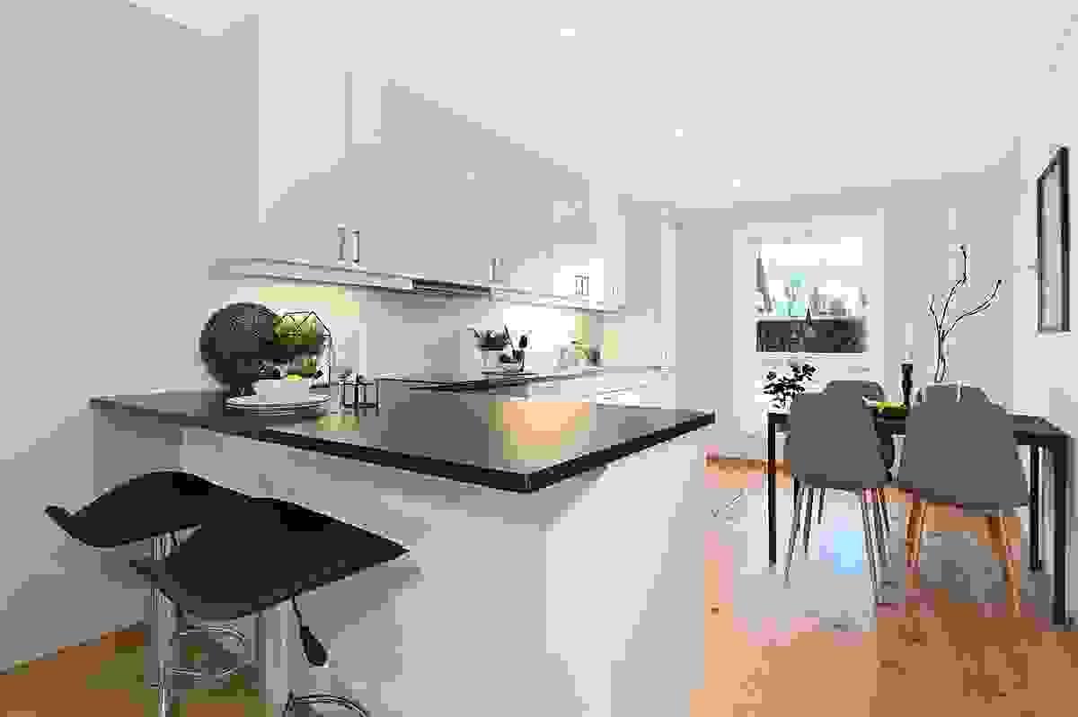 Kjøkken med avsatt plass til kjøkkenbord