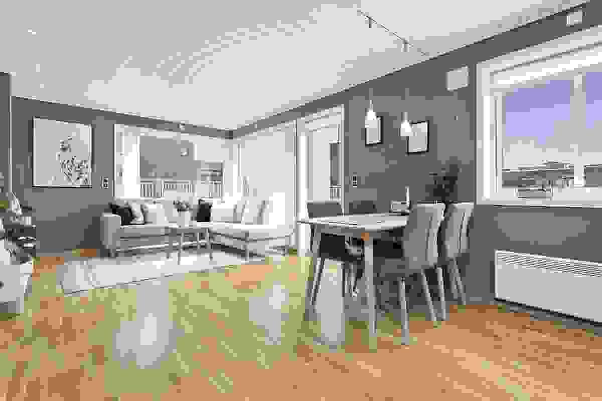 Rommet har god plass for sofaløsning med tilhørende møblement og spisebord.
